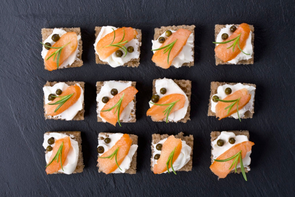 Artistic shot of carefully played salmon appetizers