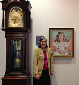 Margaret Ann Goldsmith with her family's grandfather clock