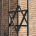 Star of David on metal fence of Old Synagogue in jewish district of Cracow - Kazimierz on Szeroka street in Poland
