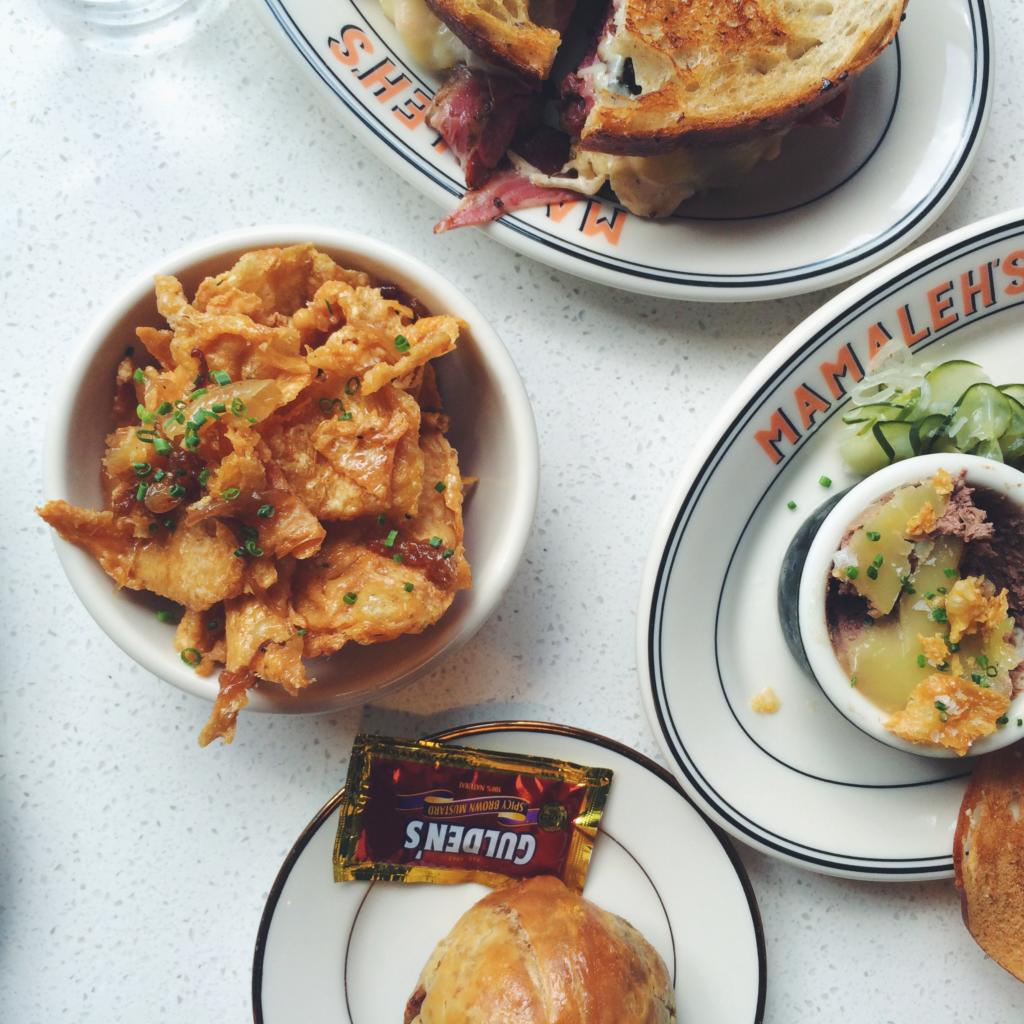 Gribenes, Pastrami and Potato Knish, Chopped Liver, and Rueben Sandwich. Photo by Aly Miller.
