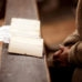 Old woman is reading a Holy Bible in a church and praying.