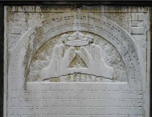A depiction of the hand gesture using during the Kohanim priestly blessing, something that often appears on gravestones of Kohanim. (Wikimedia Commons)