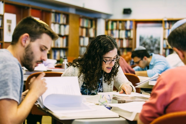 Students studying Jewish texts in the beit midrash (study hall) Mechon Hadar, an educational institution in New York City working to empower Jews to create and sustain vibrant, practicing, egalitarian communities of Torah learning, prayer and service. (Emil Cohen/Mechon Hadar)