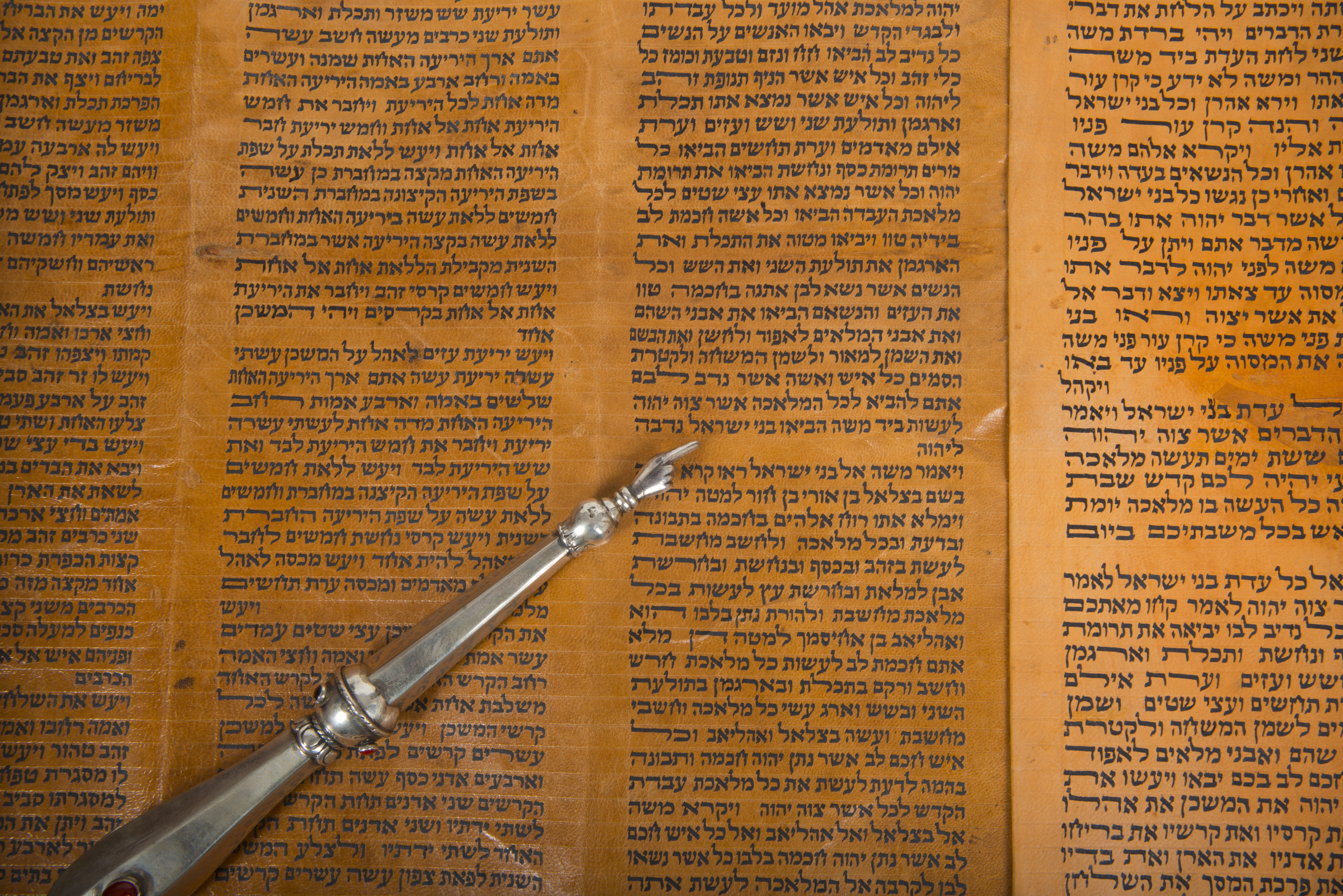 an ancient torah scroll close up