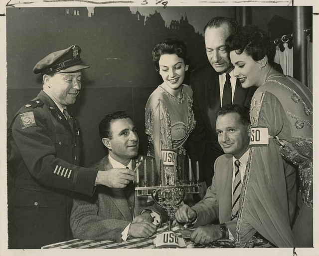 Chaplain (Lt. Col.) Samuel W. Chomsky lights the Hanukkah candles at a USO-Jewish Welfare Board dinner and show in Hollywood, California, Dec. 19, 1954. (Courtesy of the American Jewish Historical Society)