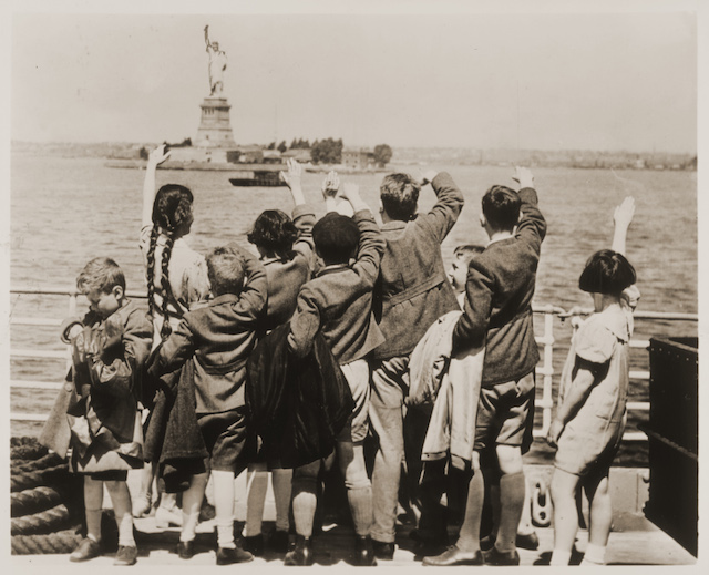 Jewish refugee children wave at the Statue of Liberty as the President Harding steams into New York harbor, June 3, 1939. (United States Holocaust Memorial Museum, Courtesy of Anita Willens)