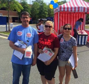 """""""Joanna, center in the paid leave shirt, with fellow JUFJ leaders of the paid leave campaign canvassing at a family health festival over the summer."""""""