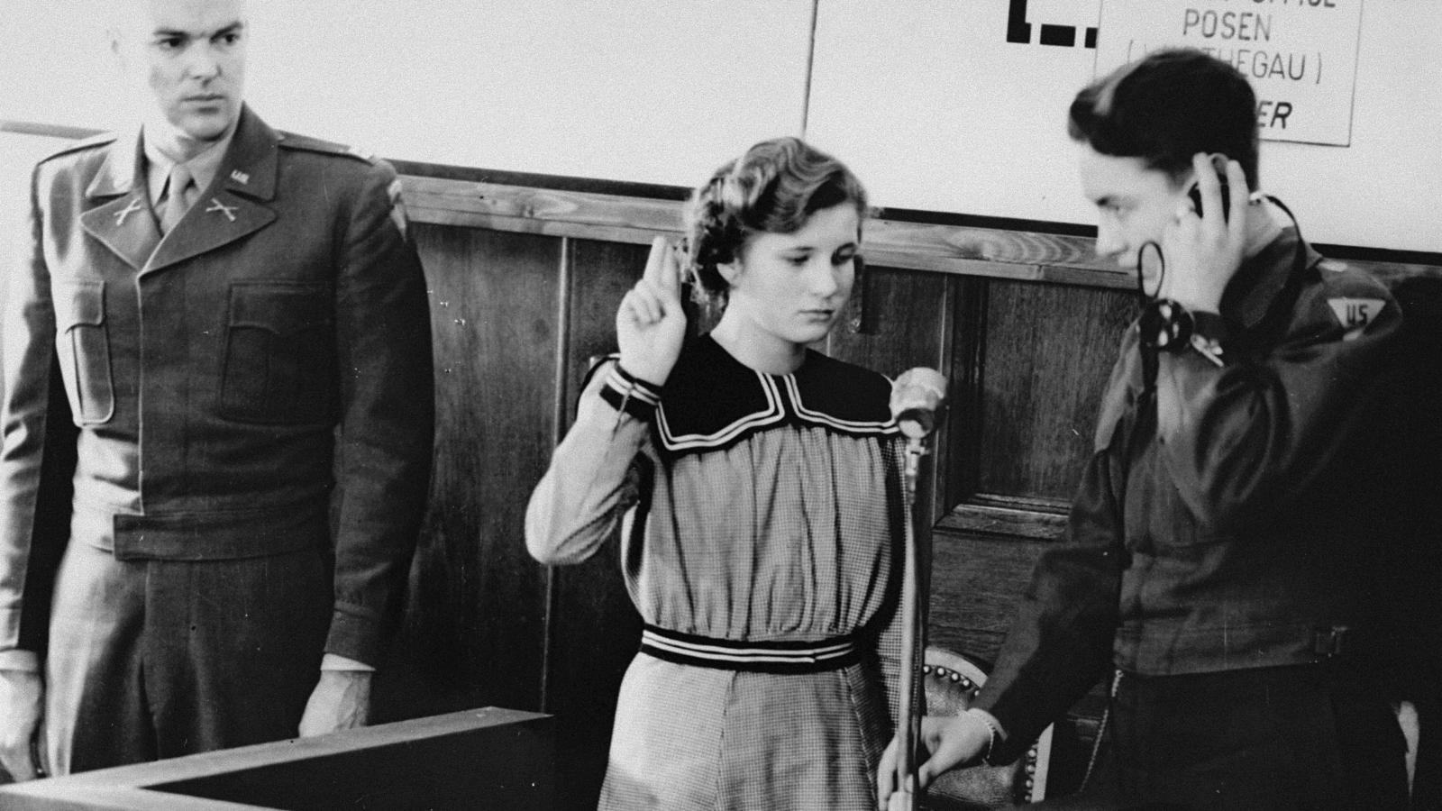 Maria Dolezalova, one of the children kidnapped by the Germans after they destroyed the Czech town of Lidice, is sworn in as a prosecution witness at the RuSHA Trial, Oct. 30, 1947. RuSHA was the Main Race and Resettlement Office, a central organization in the implementation of racial programs of the Third Reich. (United States Holocaust Memorial Museum, Courtesy of Hedwig Wachenheimer Epstein)