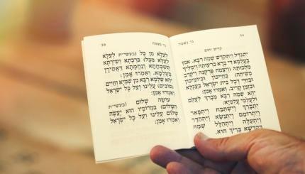 man holding kaddish prayer