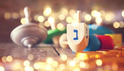 Image of jewish holiday Hanukkah with wooden dreidels
