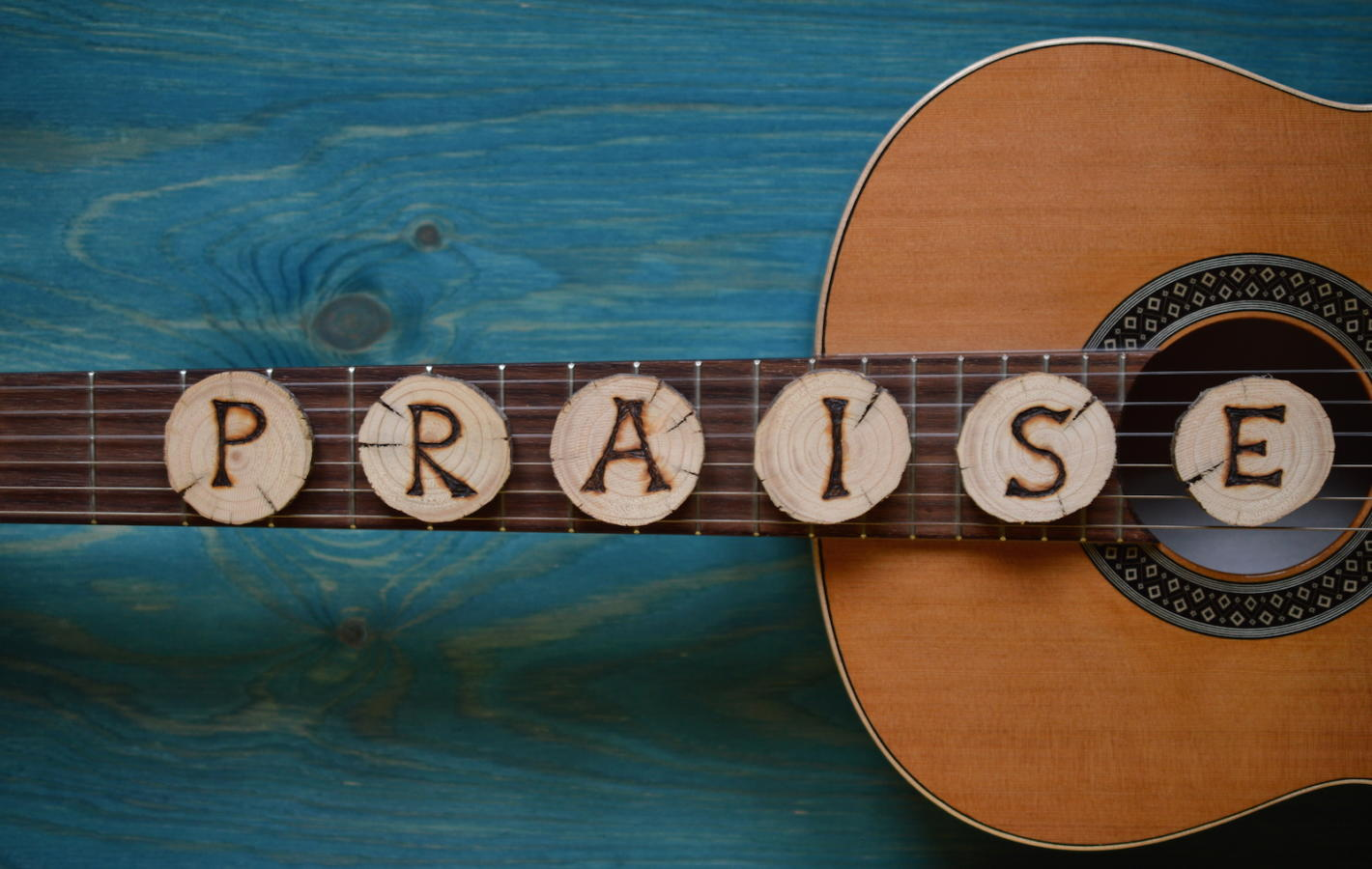 guitar with word praise