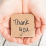 Two hands offering their gratitude & thanks