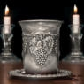 Jewish Sabbath traditional silver kiddush cup on wood texture
