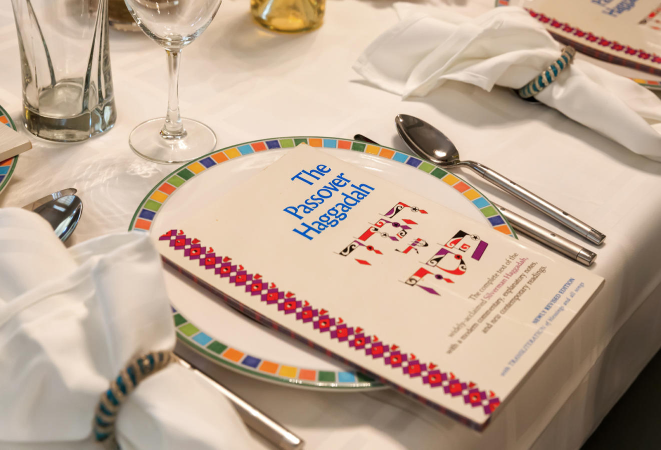 Traditional Passover Seder Table with Haggadah