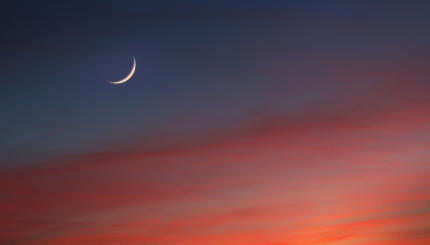 Crescent Moon in Glowing Sunset Skies