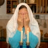A Jewish woman blessing the Sabbath candles