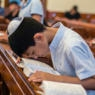 A boy bows for prayer during Mincha service in the Six-domed Synagogue in Qırmızı Qəsəbə, or Red Town, Quba district of Azerbaijan on 28 September 2016. Qırmızı Qəsəbə is a biggest compact settlement of the Mountain Jews in the world. The population of the Town is near 4 thousand people. Residents of the Red Town work and live mostly in Moscow. They build or renovate houses and residences and spend in the town summer vacations. People also use to come back to the Qırmızı Qəsəbə when one of the relatives die. They visit a Synagogue every day for special prayer. ( (Photo by Oleksandr Rupeta/NurPhoto))