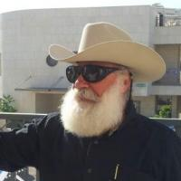Tour guide in cowboy hat with large white beard