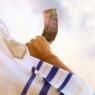 Jewish man blowing the Shofar (horn) of Rosh Hashanah (New Year). Religious symbol