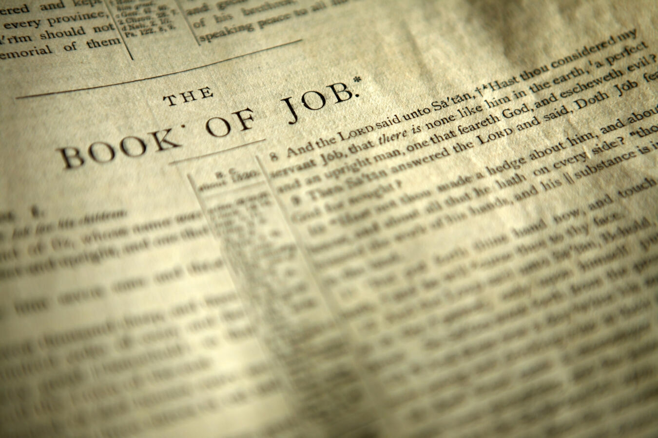 Bible open to the first page of the Book of Job.