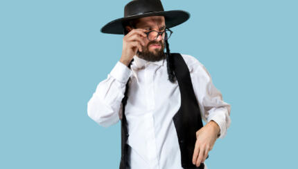 A Hasidic Jew squinting angrily over his glasses.